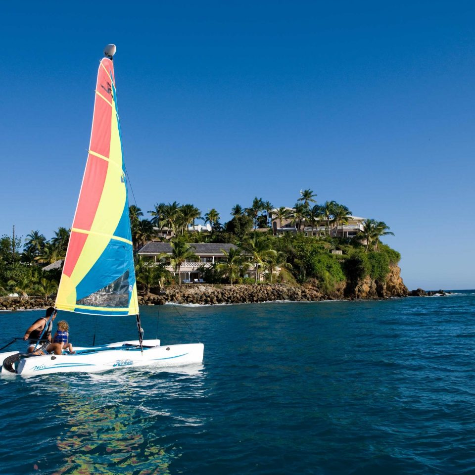 Adventure Beachfront Boat Honeymoon Island Outdoor Activities Resort Romance Romantic Sport Tropical water sky watercraft transport sailing vessel sailboat sail Sea vehicle sailing windsurfing Ocean sports Lake boating wind catamaran