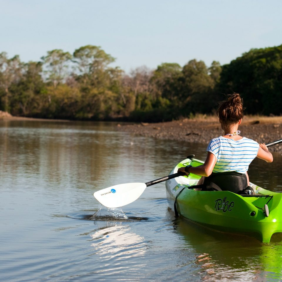 Adventure Beachfront Parks Sport Wellness water tree sky Boat boating kayak vehicle canoeing kayaking green watercraft rowing Lake River sports equipment canoe watercraft paddle sea kayak