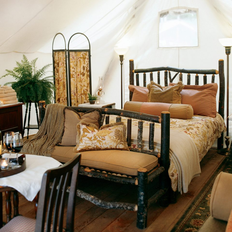 Adventure Bedroom Family Forest Mountains Outdoors Play Romantic Rustic Scenic views Sport Waterfront Wellness chair living room property home cottage farmhouse Suite Villa