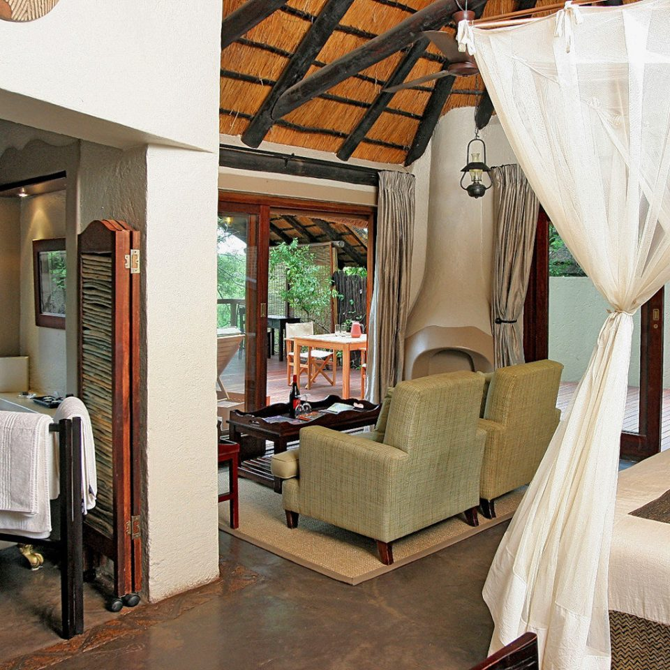 Adventure Bedroom Honeymoon Outdoors Romance Rustic property chair home house cottage Villa farmhouse Suite living room