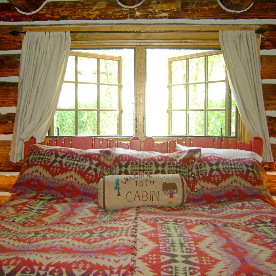 Adventure Bedroom Mountains Natural wonders Nature Outdoor Activities Outdoors Ranch Scenic views property house living room home cottage bed sheet log cabin textile