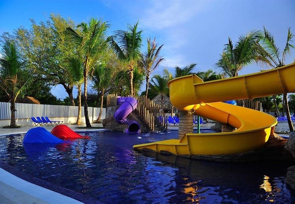 Adventure Family Play Pool Resort Tropical tree water sky leisure amusement park Water park Boat swimming pool park outdoor recreation recreation vehicle swimming colorful palm colored