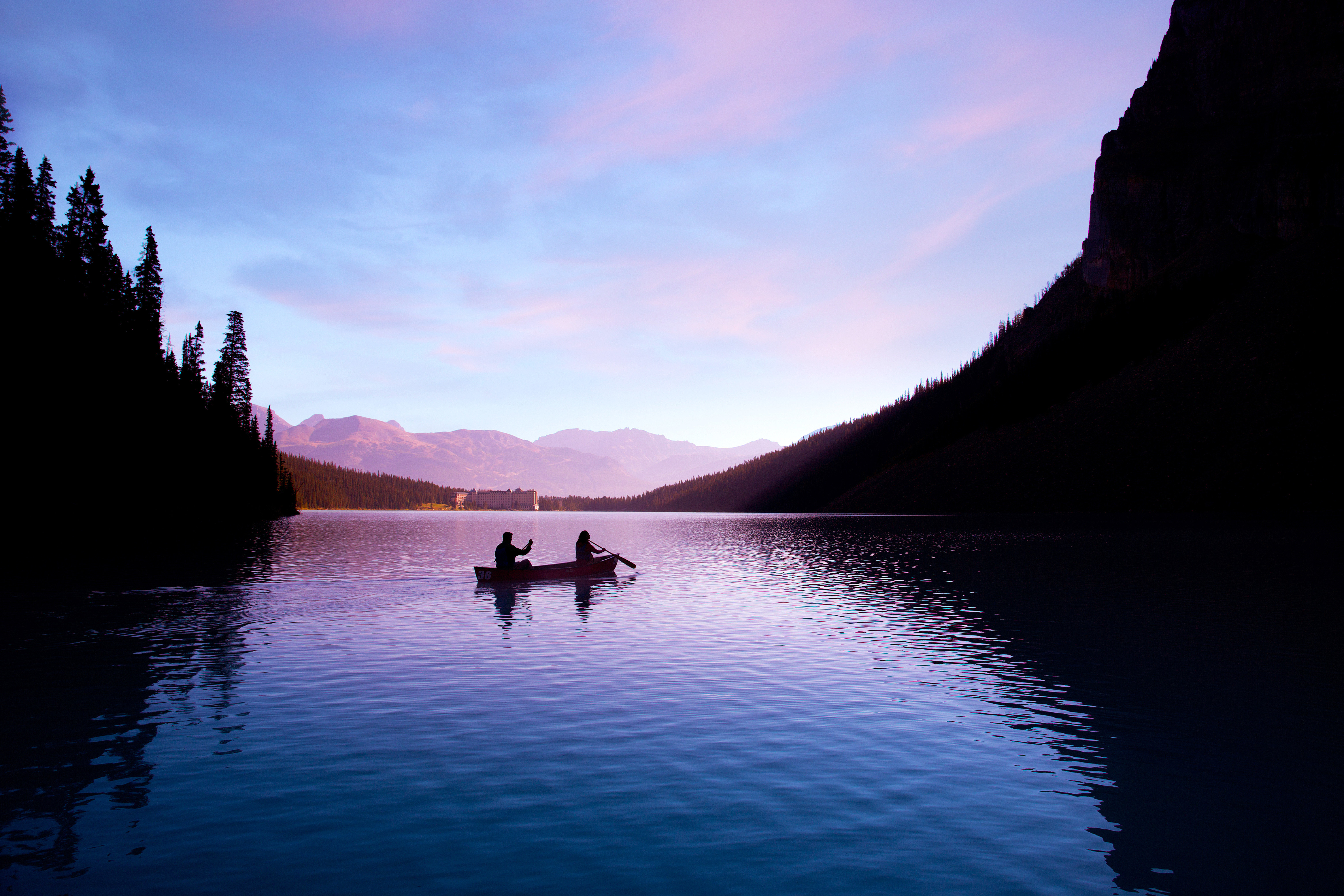 Adventure Natural wonders Resort Scenic views Sport water sky Boat Lake mountain River loch morning Sea dusk dawn Nature evening Sunset fjord surrounded clouds distance