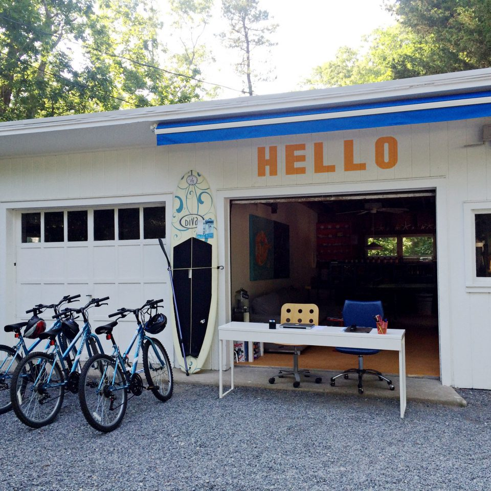 Adventure Boutique Budget Exterior Grounds Hip Outdoor Activities Outdoors bicycle tree parked house vehicle home restaurant cottage