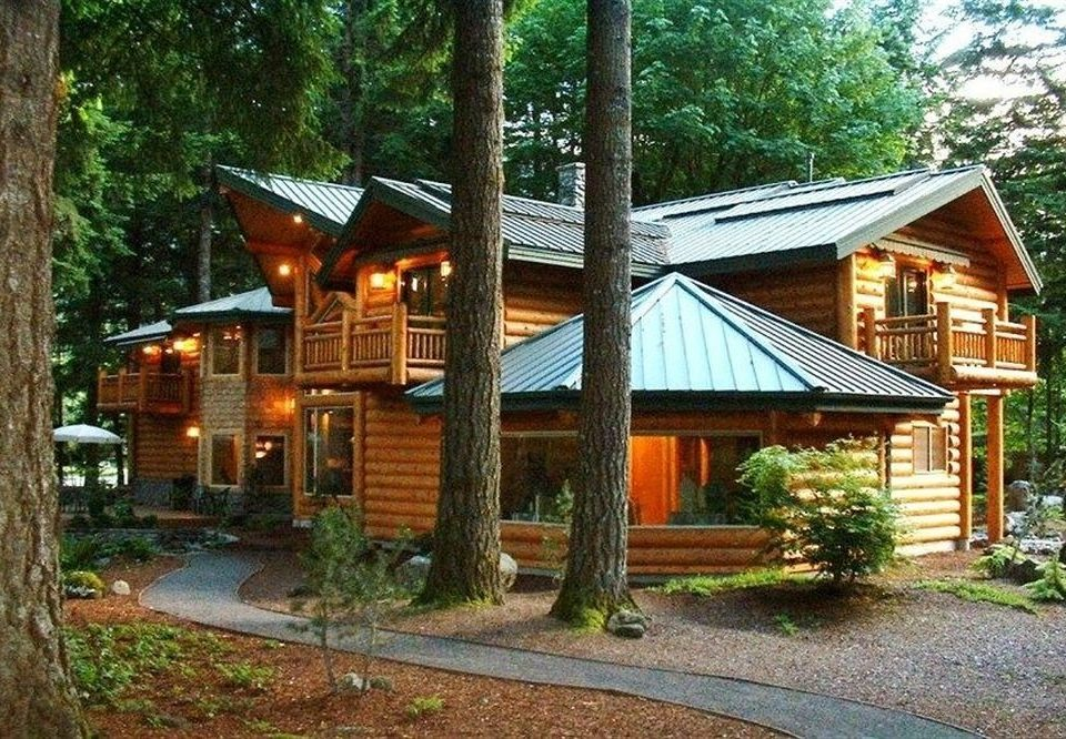Adventure Buildings Cabin Exterior Forest Grounds Lodge Outdoors Rustic Sport Wellness tree grass property log cabin Resort home cottage hut house