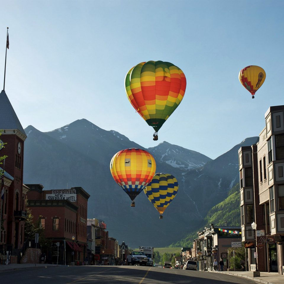 Adventure Buildings Entertainment Mountains Scenic views Town transport balloon aircraft sky Hot Air Balloon vehicle hot air ballooning atmosphere of earth toy