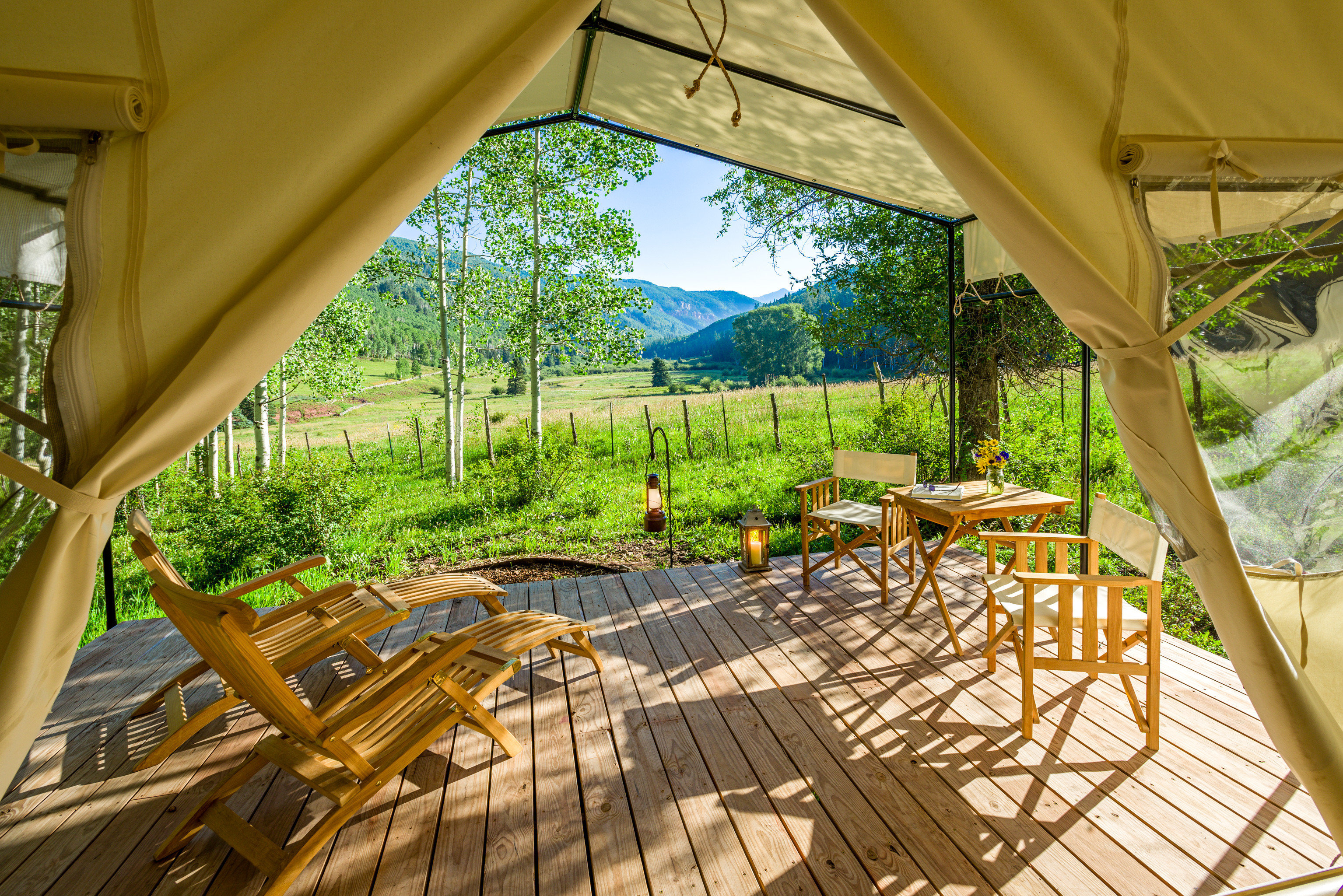 Adventure Country Deck Forest Glamping Mountains Rustic Scenic views Wellness chair tree property building Resort Villa porch backyard cottage eco hotel