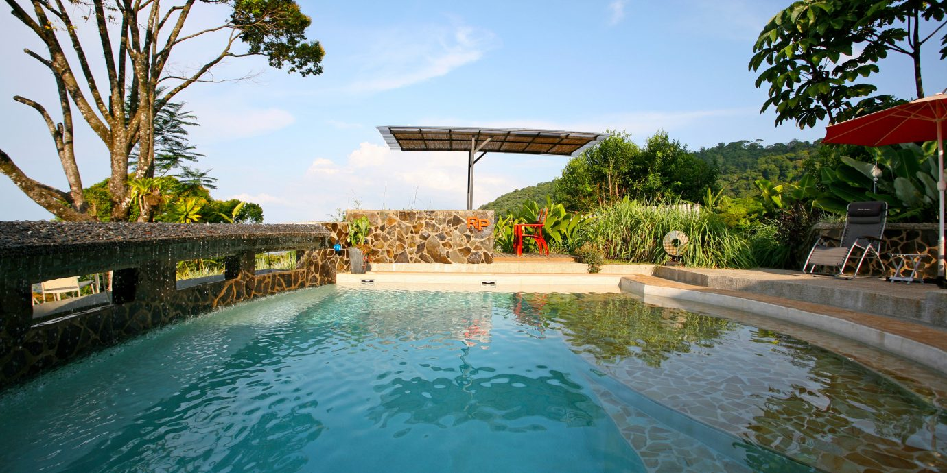 Adventure Country Eco Grounds Outdoor Activities Pool Romance Rustic Scenic views Wellness tree sky swimming pool leisure property Resort resort town Villa Lagoon shore day