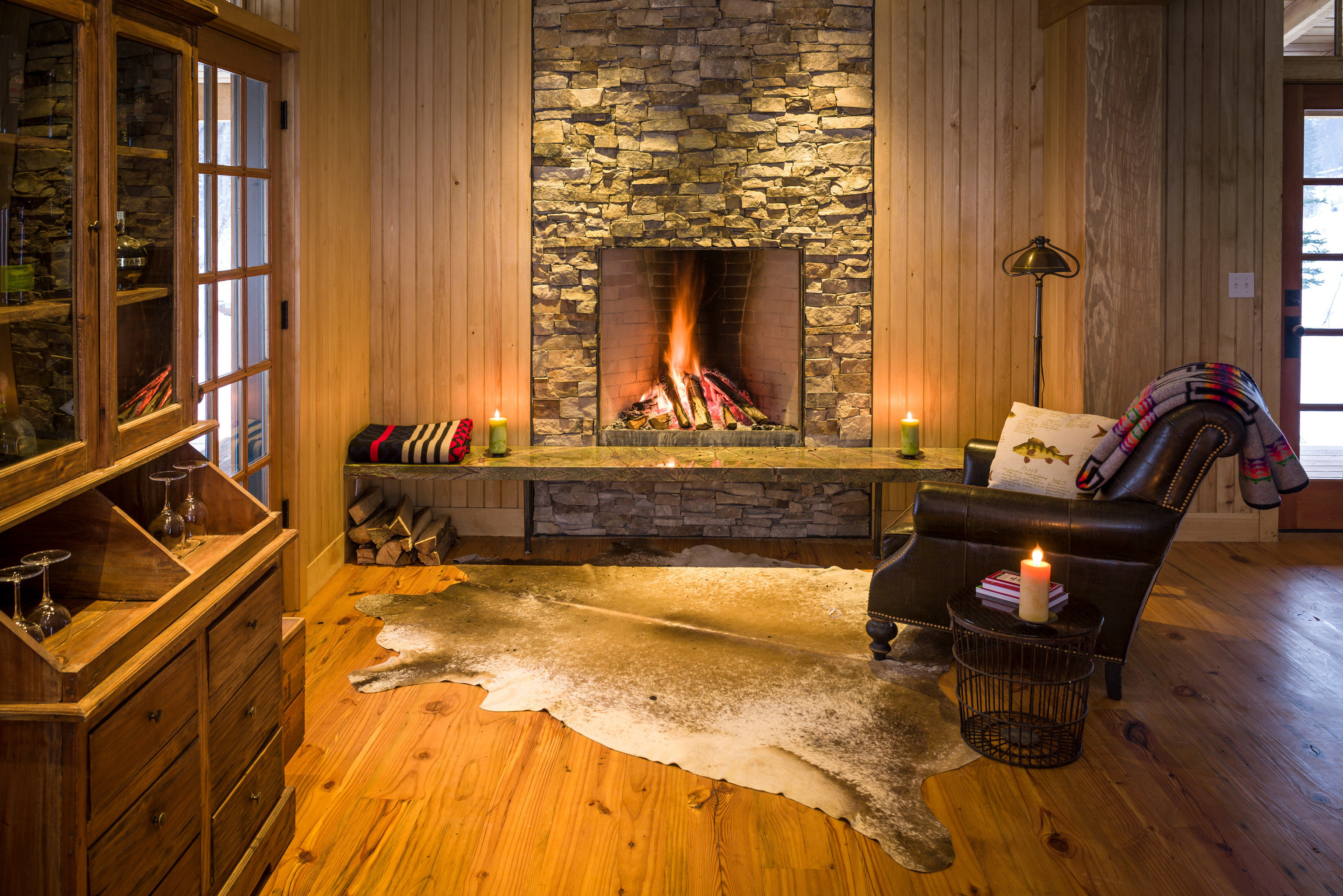 Adventure Country Forest Glamping Mountains Outdoors + Adventure Rustic Weekend Getaways Wellness building property Fireplace home hearth hardwood living room house cottage wooden wood flooring farmhouse flooring hard