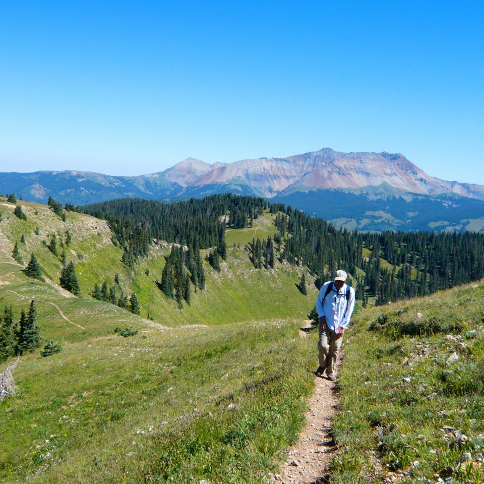 Adventure Country Forest Glamping Mountains Natural wonders Rustic Scenic views Wellness mountain sky grass Nature mountainous landforms ridge mountain range hill mountain biking grassland trail fell mountain pass mountain bike walking alps sports plateau hiking meadow hillside dirt highland lush