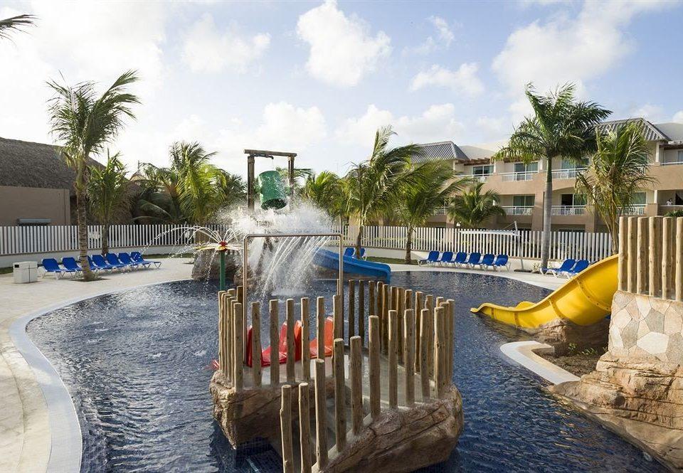 Adventure Family Play Pool Resort Tropical sky water leisure property swimming pool yellow home Villa Water park dock walkway waterway shore