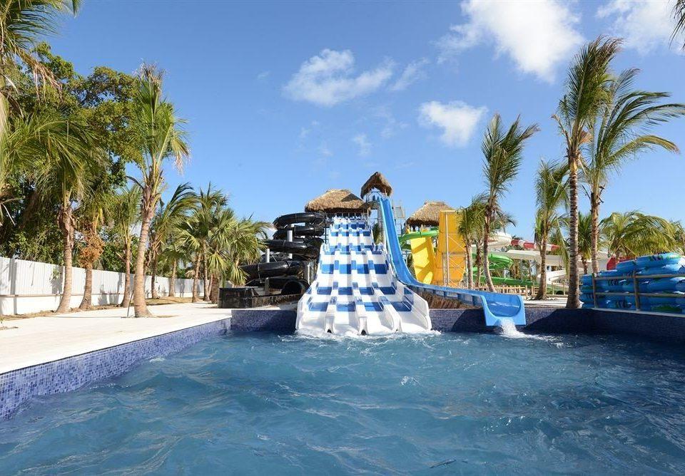 Adventure Family Play Pool Resort Tropical tree sky water leisure swimming pool palm Water park amusement park park blue