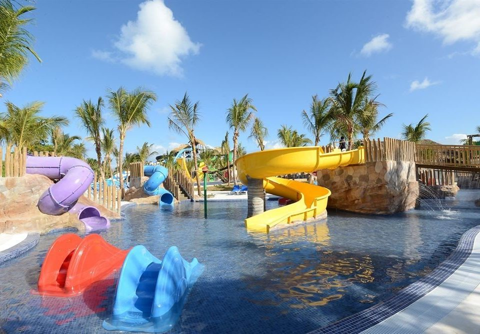 Adventure Family Play Pool Resort Tropical sky tree Water park leisure amusement park swimming pool outdoor recreation palm park recreation