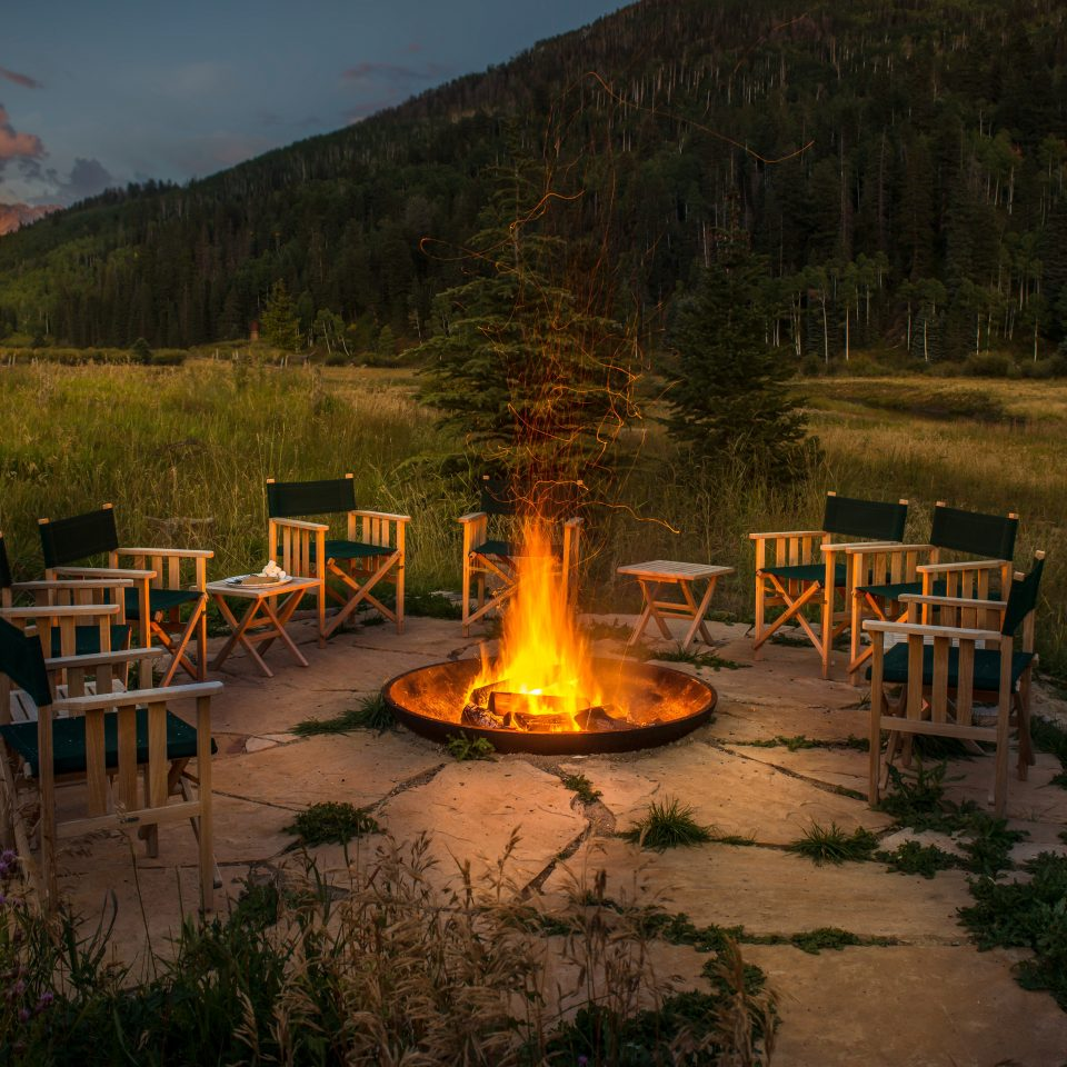 Adventure Glamping Scenic views grass sky mountain wilderness yellow morning Nature evening park campfire fire autumn surrounded