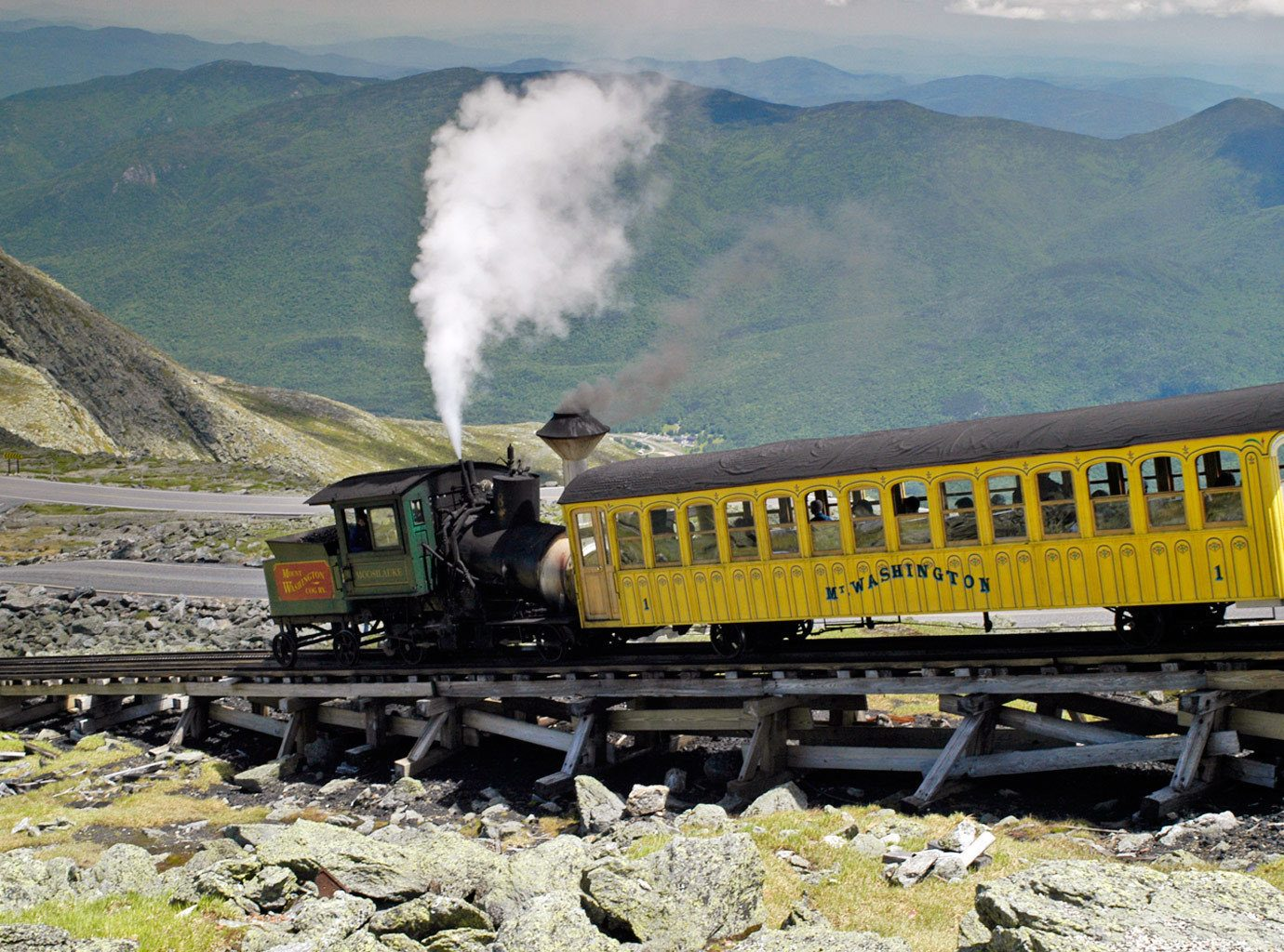Adventure Mountains Natural wonders Nature Outdoor Activities Outdoors Scenic views mountain sky ground transport train vehicle rail transport track locomotive rolling stock railroad car hillside