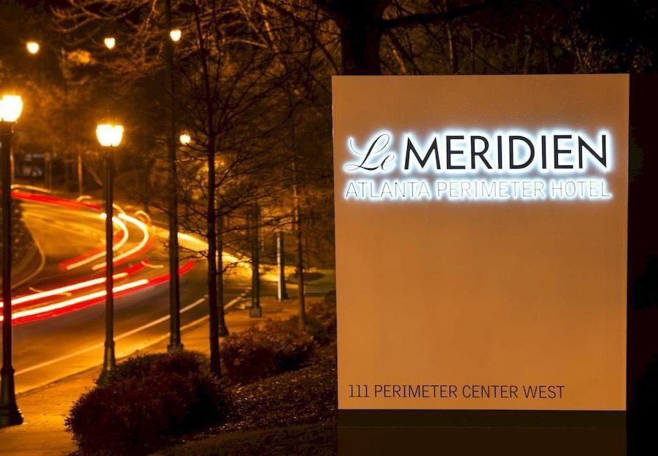 night sign light lighting evening brand advertising signage