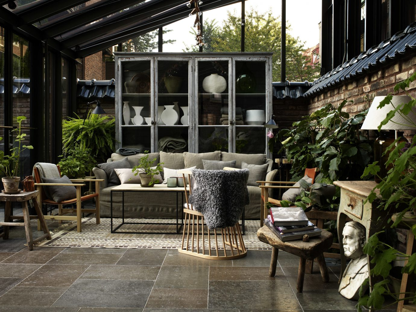 Design Hotels Stockholm Sweden building outdoor Patio Courtyard outdoor structure furniture plant window backyard interior design stone area
