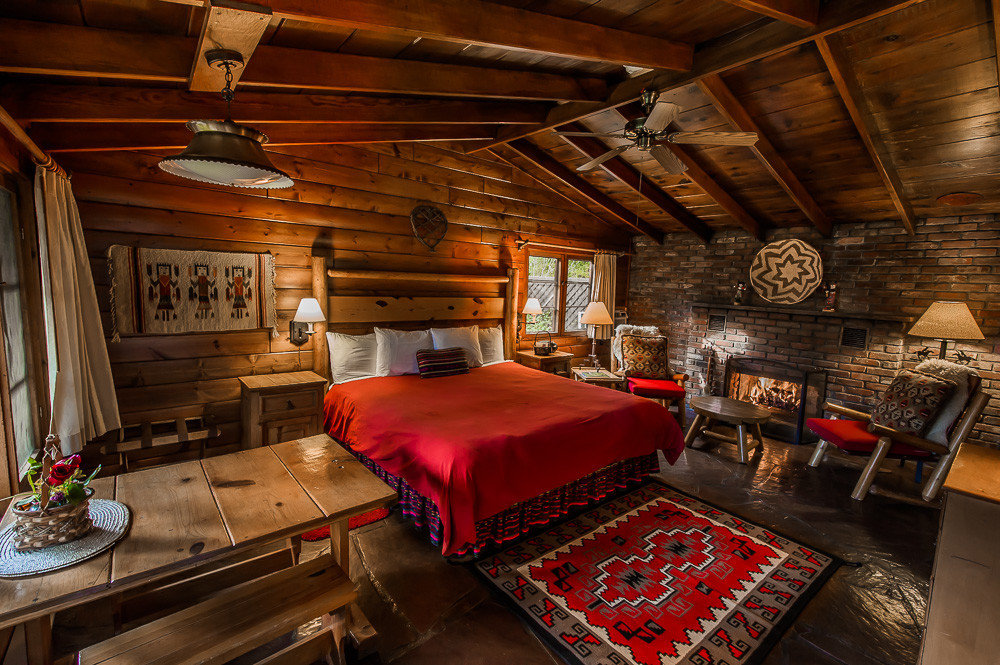 Boutique Hotels Fall Travel Hotels Outdoors + Adventure indoor floor ceiling room interior design wood home red Bedroom house real estate living room log cabin estate beam furniture