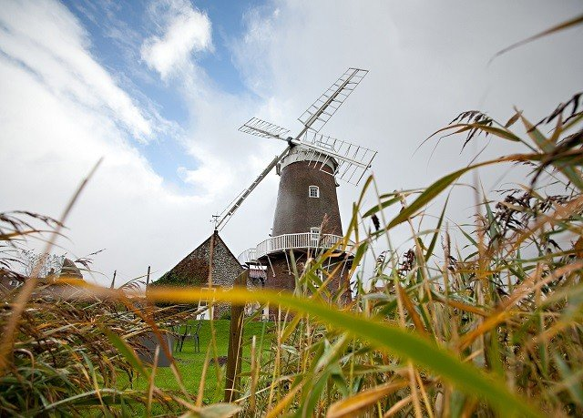 sky windmill mill outdoor object grass prairie rural area wind agriculture grass family