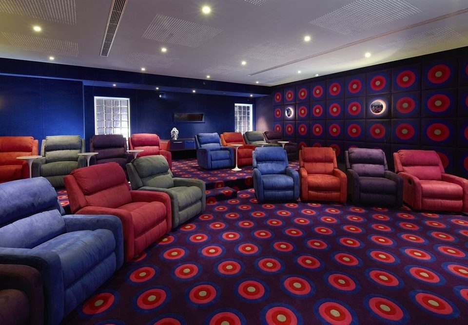 airline movie theater red recreation room conference hall auditorium screenshot aircraft cabin blue colored