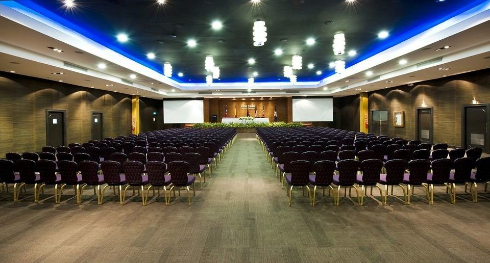 auditorium function hall airport conference hall long convention center ballroom audience row lined line walkway basement conference room