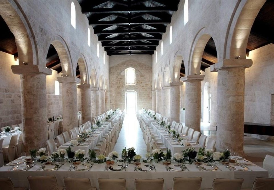 aisle ceremony function hall ballroom arch stone colonnade