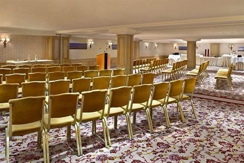 chair function hall auditorium banquet conference hall ballroom convention center aisle palace empty