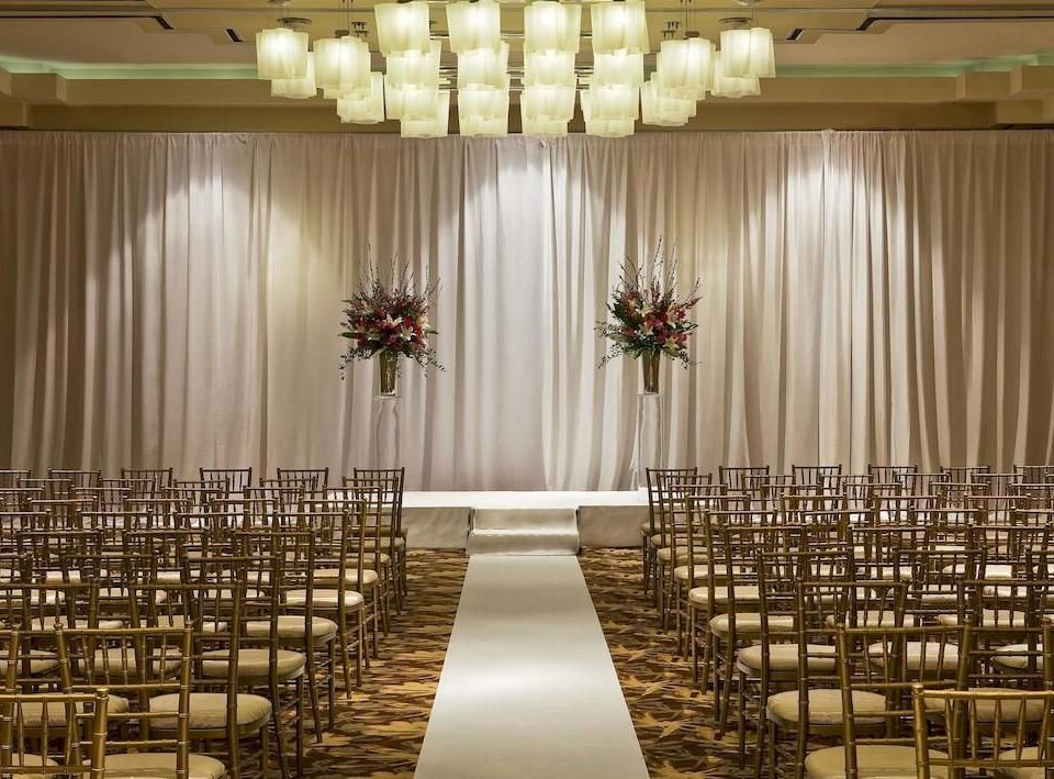 auditorium aisle function hall stage ceremony ballroom wedding banquet curtain convention center window treatment