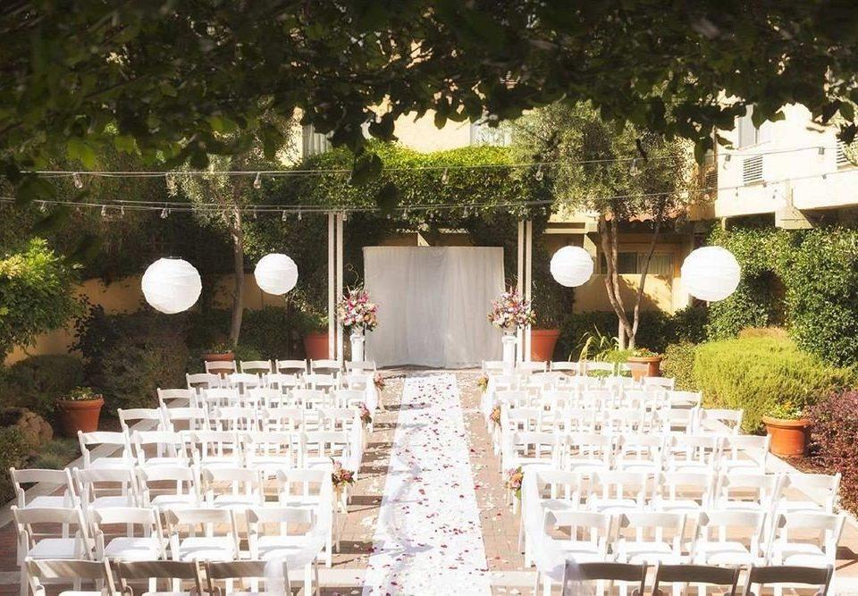 tree aisle wedding ceremony white backyard flower banquet wedding reception set