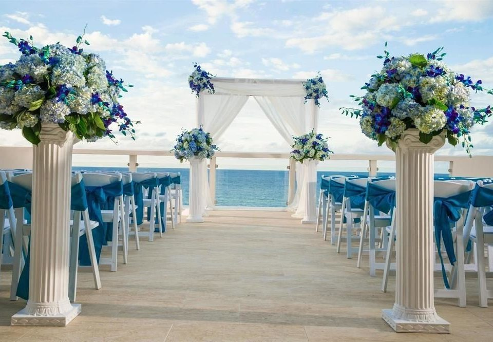 aisle blue wedding ceremony flower wedding reception floristry flower arranging function hall floral design colonnade