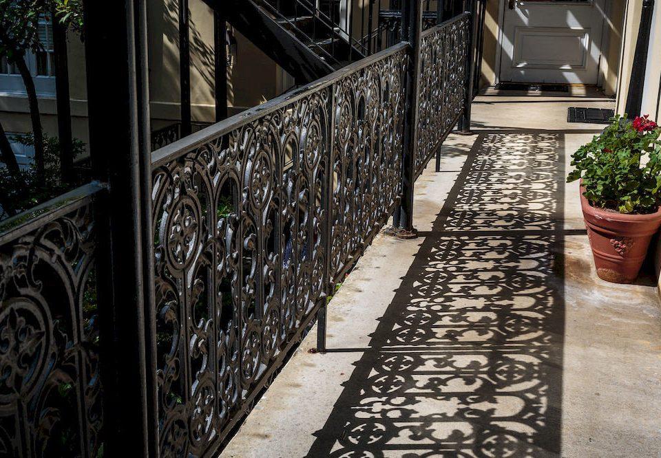 ground building sidewalk aisle flooring stairs handrail outdoor structure