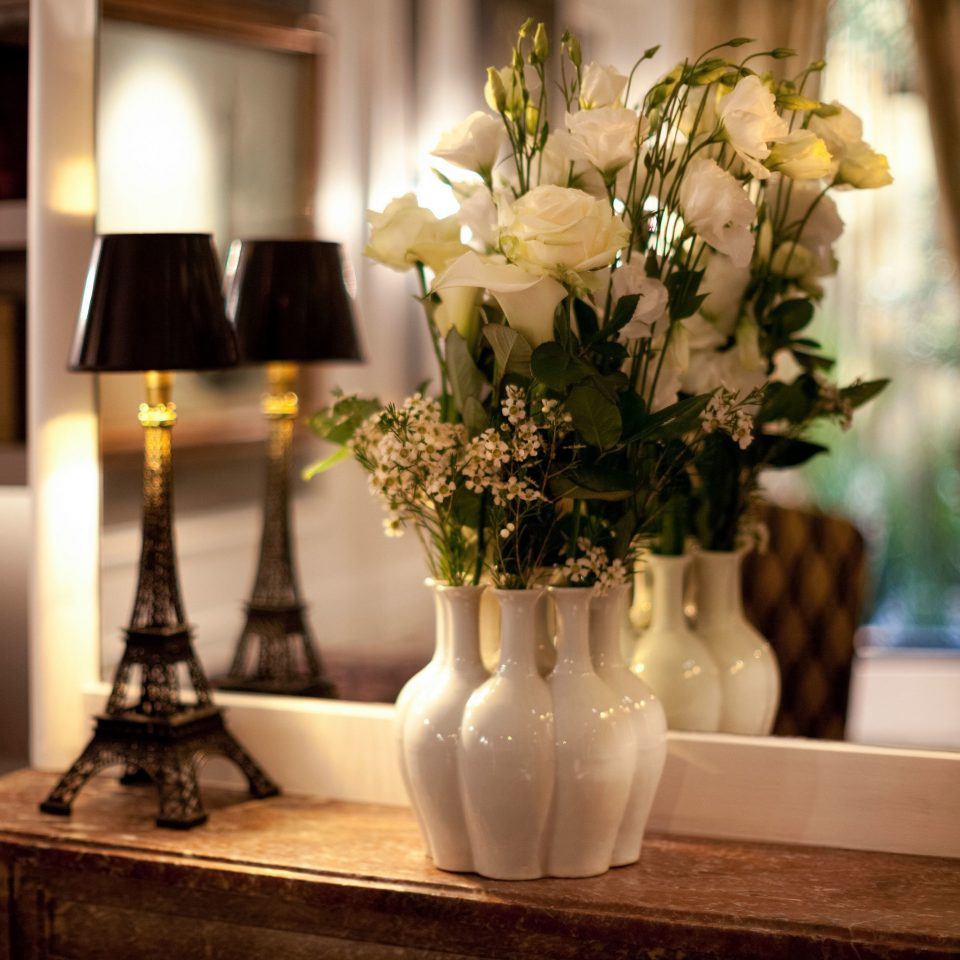 flower arranging flower floristry centrepiece ceremony wedding floral design lighting shelf home aisle dining table