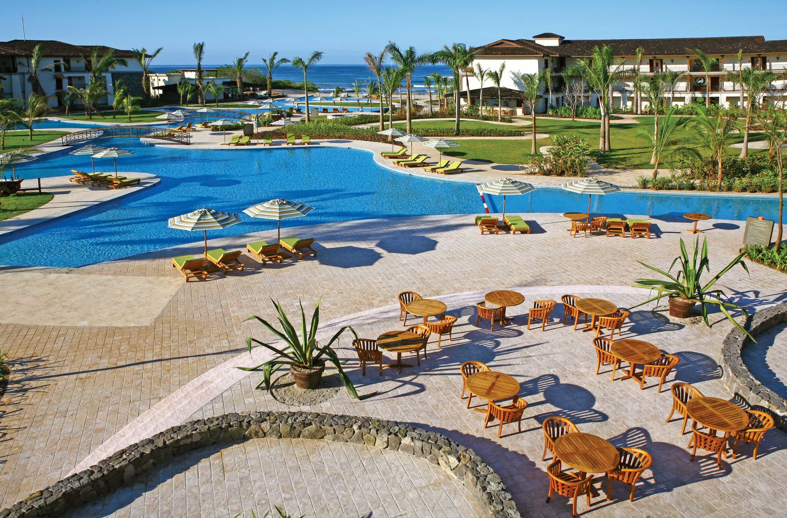 All-inclusive Architecture Buildings Exterior Hotels Pool Resort sky leisure swimming pool Beach Water park walkway Sea lawn marina dock lined shore sandy