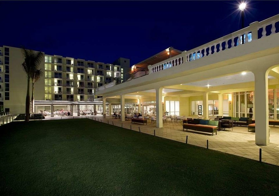 All-inclusive Beachfront Exterior Grounds Tropical grass night building Architecture colonnade