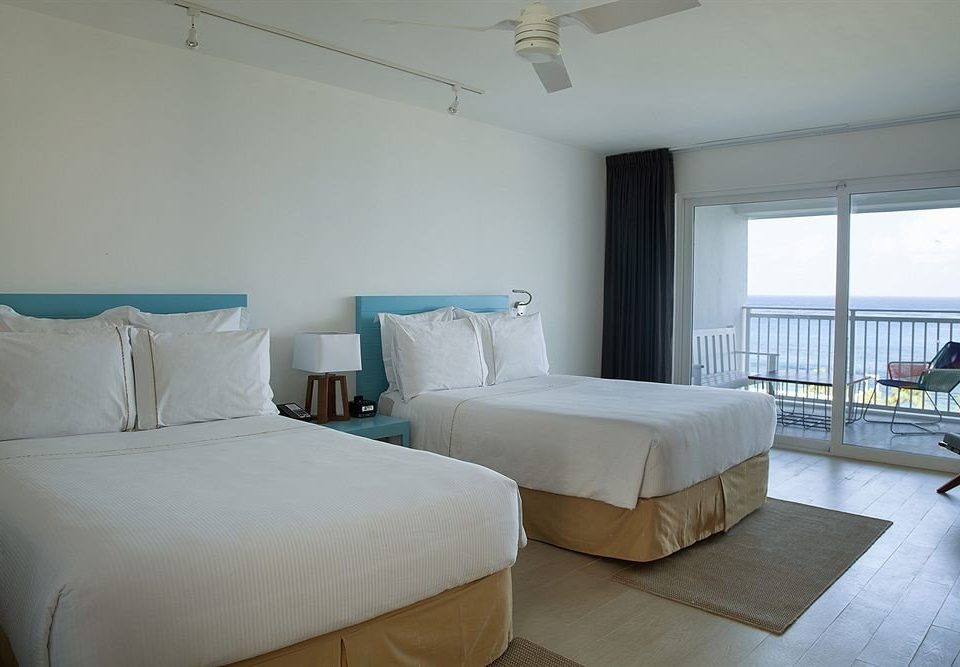 All-inclusive Balcony Beachfront Bedroom Modern Waterfront property building condominium cottage Suite Villa tan