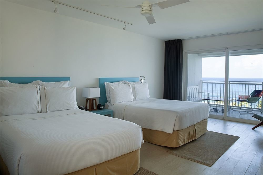 All-inclusive Balcony Beachfront Bedroom Modern Waterfront property building condominium cottage Suite Villa tan