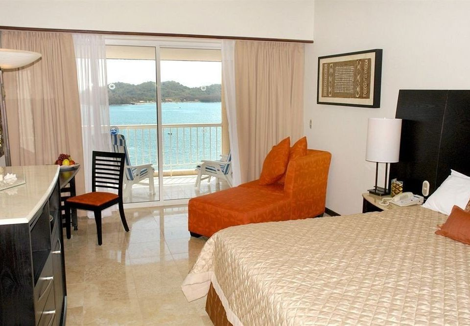 All-inclusive Balcony Beachfront Bedroom Modern Resort Scenic views Waterfront chair property Suite cottage Villa nice living room containing