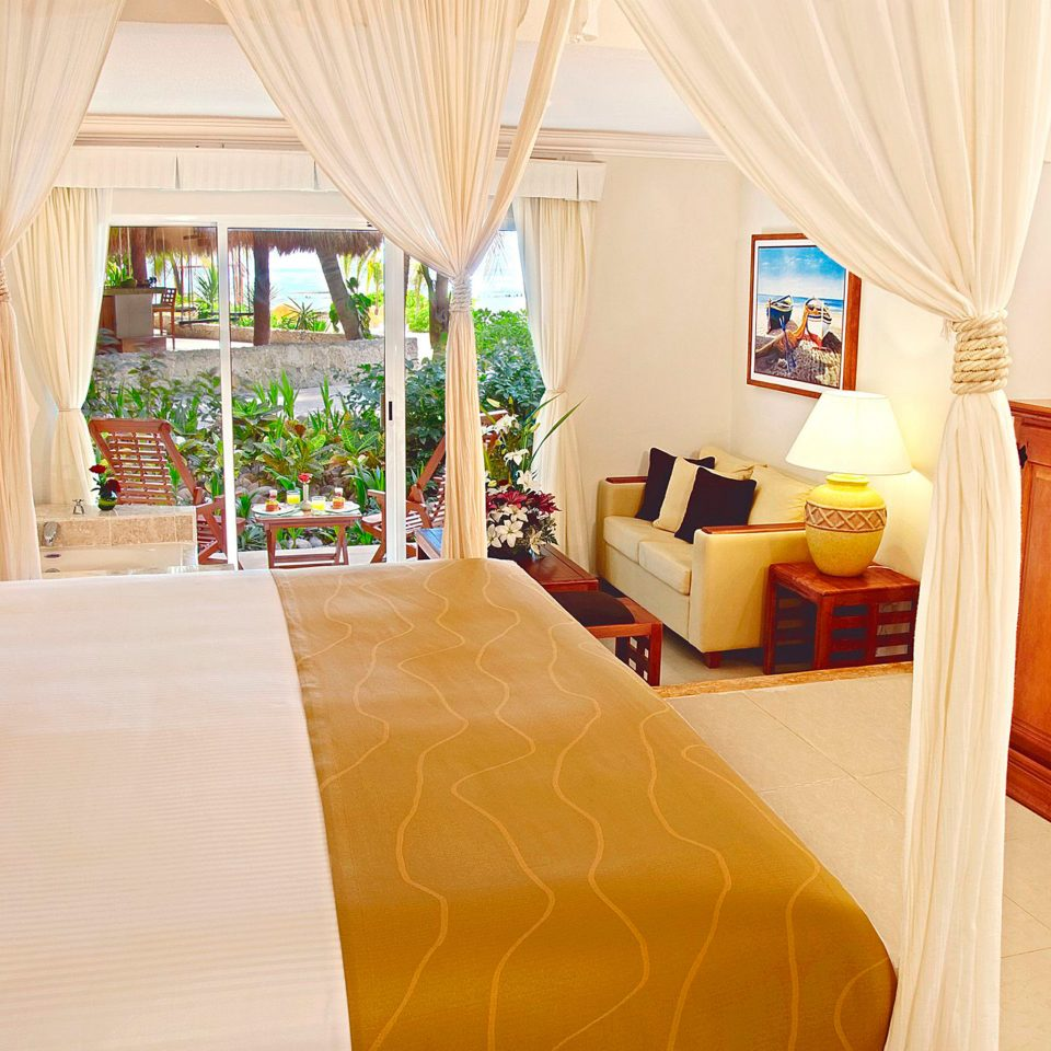 All-inclusive Balcony Bedroom Modern Suite Tropical Waterfront property cottage home Villa Resort living room
