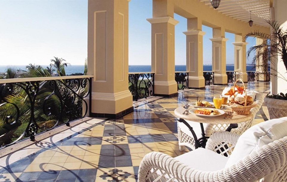 All-inclusive Balcony Dining Resort property home living room Villa condominium porch mansion outdoor structure Lobby cottage flooring