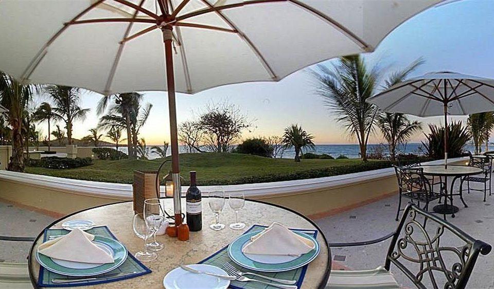 All-inclusive Balcony Dining Resort umbrella accessory property swimming pool Villa restaurant home cottage