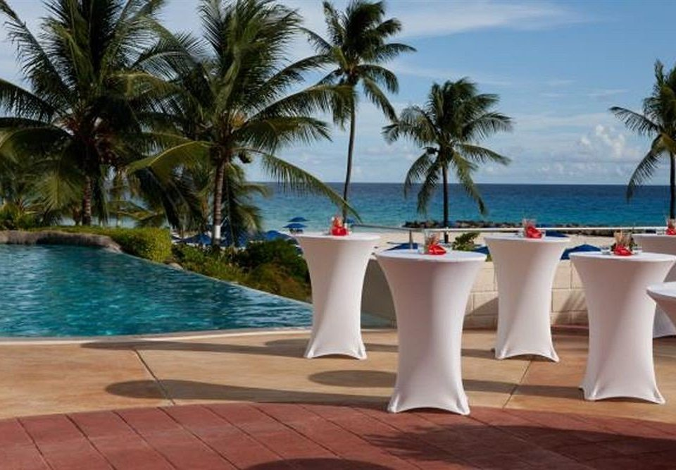 All-inclusive Bar Dining Drink Eat tree water leisure palm property swimming pool Resort caribbean Villa Beach arecales plant lined shore Island