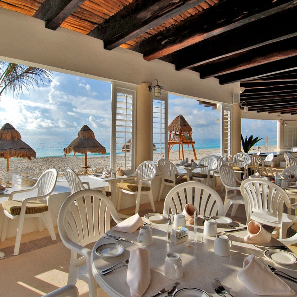 All-inclusive Bar Beachfront Dining Drink Eat Elegant Patio Romantic chair restaurant Resort wedding white function hall dining table