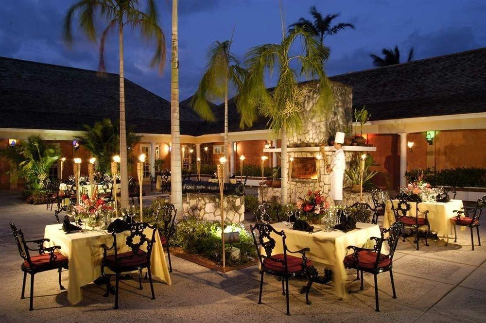 All-inclusive Bar Beachfront Dining Drink Eat Exterior Grounds Tropical chair restaurant Resort hacienda