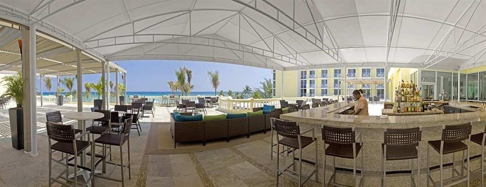 All-inclusive Bar Beachfront Drink Scenic views Tropical chair property Resort convention center plaza restaurant
