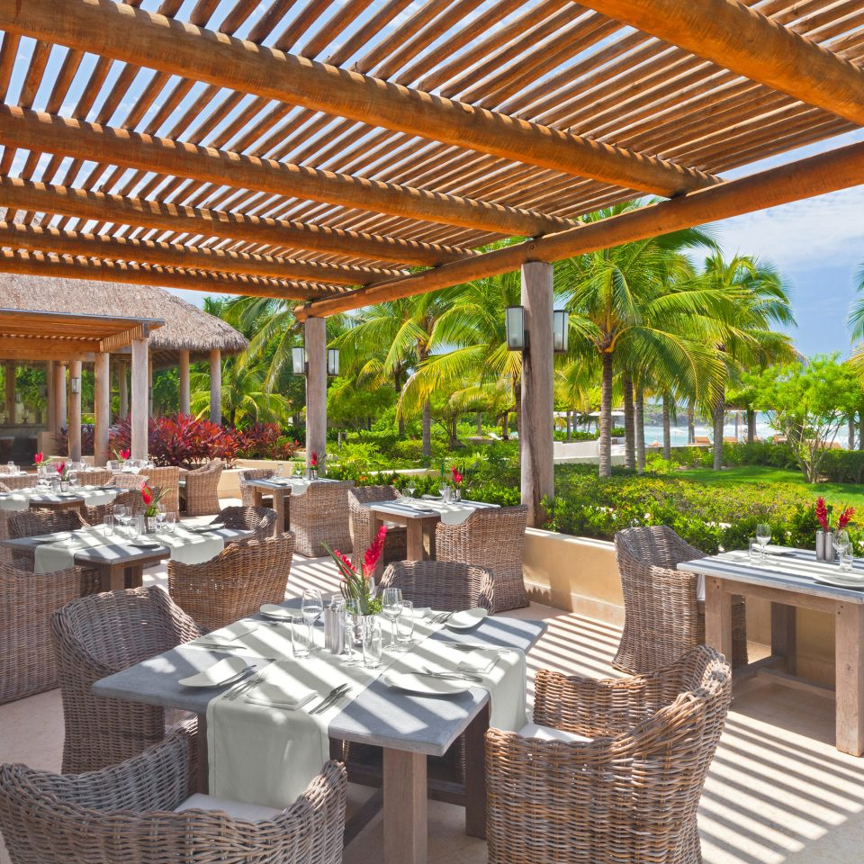 All-inclusive Bar Dining Drink Eat Hip Tropical ground property chair building Resort outdoor structure Villa porch backyard Courtyard pergola restaurant hacienda Patio