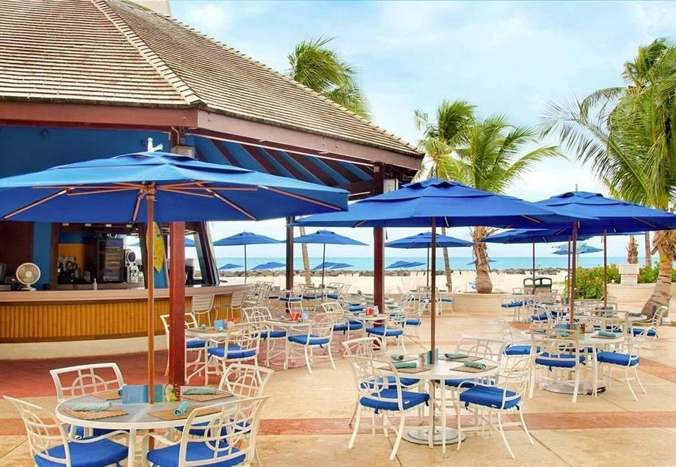 All-inclusive Bar Dining Drink Eat chair umbrella lawn leisure property Resort swimming pool blue restaurant caribbean Villa Deck set shade
