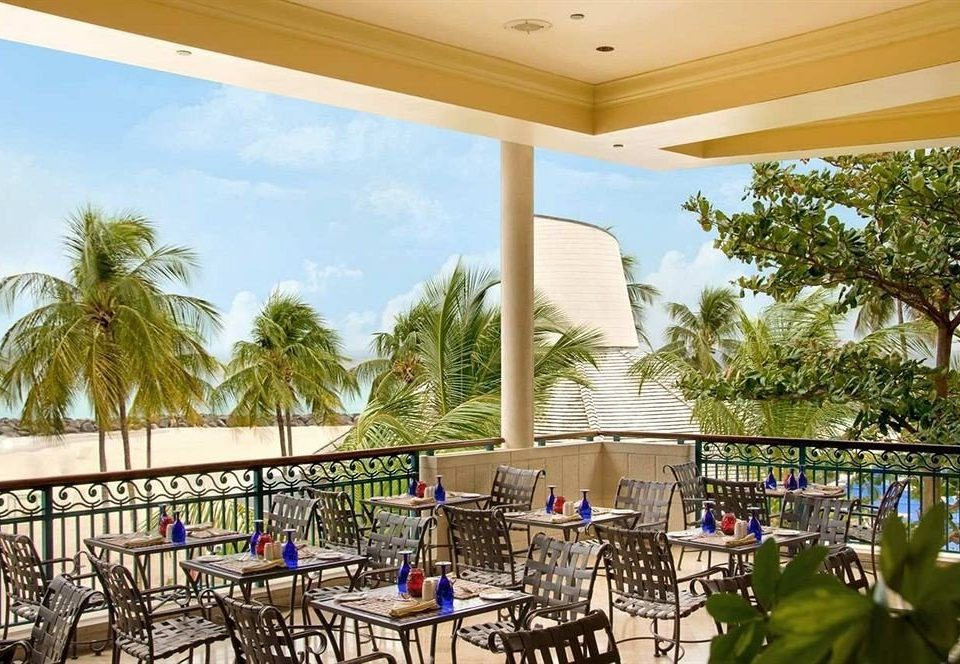 All-inclusive Bar Dining Drink Eat tree building chair property Resort home condominium Villa porch backyard Deck mansion swimming pool hacienda restaurant