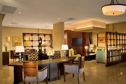 All-inclusive Bar Dining Drink Eat Hip Luxury property Lobby living room condominium Suite dining table