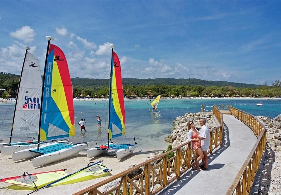 All-inclusive Beach Beachfront Outdoor Activities Resort Tropical sky watercraft transport Sea Boat sail sailing vehicle Coast sailboat windsurfing wind boating day
