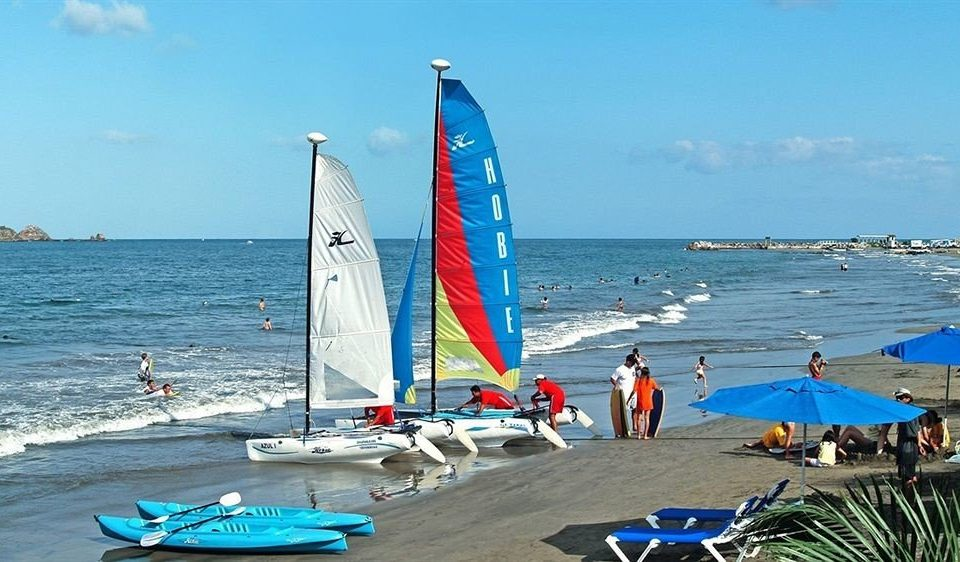 All-inclusive Beachfront Modern Resort Waterfront sky water Beach sail Sea sailboat Boat watercraft sailing vehicle Ocean Coast sports wind windsurfing sailing ship catamaran dinghy sailing windsports sailing vessel
